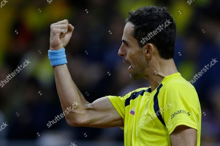 Colombia's Santiago Giraldo celebrates scoring a point against Sweden's Elias Ymer during during the first match of the Davis Cup qualification final round between Colombia and Sweden, in Bogota, Colombia