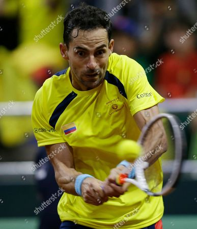 Colombia's Santiago Giraldo returns the ball against Sweden's Elias Ymer during during the first match of the Davis Cup qualification final round between Colombia and Sweden, in Bogota, Colombia