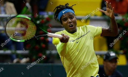 Sweden's Elias Ymer returns the ball against Colombia's Santiago Giraldo during the first match of the Davis Cup qualification final round between Colombia and Sweden, in Bogota, Colombia