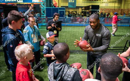 Hall of Fame Running Back LaDainian Tomlinson shares tips with young fans during a VIP clinic, hosted by the NFL Extra Points Credit Card issued by Barclays,, in Atlanta at Super Bowl Experience in the Georgia World Congress Center