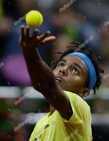 Sweden's Elias Ymer serves to Colombia's Santiago Giraldo during the first match of the Davis Cup qualification final round between Colombia and Sweden, in Bogota, Colombia
