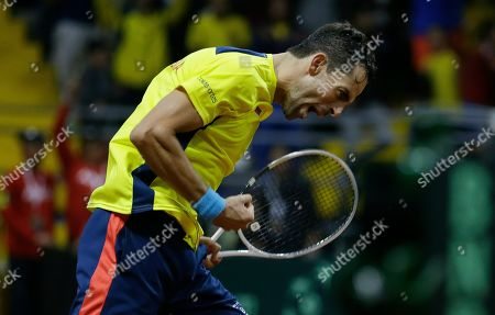 Colombia's Santiago Giraldo celebrates defeating Sweden's Elias Ymer during during the first match of the Davis Cup qualification final round between Colombia and Sweden, in Bogota, Colombia, . Girls won 6-1, 6-4