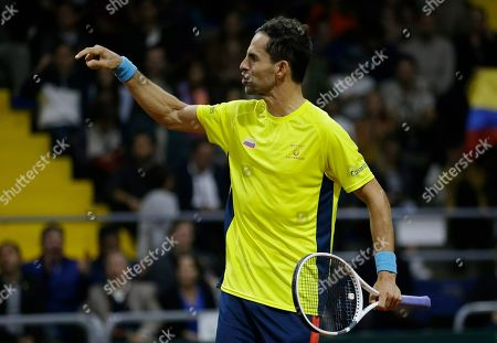 Colombia's Santiago Giraldo celebrates scoring a point against Sweden's Elias Ymer during during the first match of the Davis Cup qualification final round between Colombia and Sweden in Bogota, Colombia