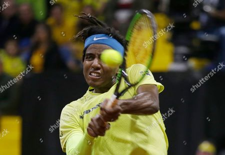 Sweden's Elias Ymer returns the ball against Colombia's Santiago Giraldo during the first match of the Davis Cup qualification final round between Colombia and Sweden in Bogota, Colombia