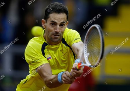 Colombia's Santiago Giraldo returns the ball against Sweden's Elias Ymer during during the first match of the Davis Cup qualification final round between Colombia and Sweden in Bogota, Colombia, . Giraldo won 6-1, 6-4