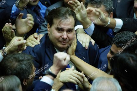 Brazilian conservative deputy Rodrigo Maia (C) celebrates after being elected as president of the Chamber of Deputies of Brazil, in Brasilia, Brazil, 01 February 2019. Rodrigo Maia of the Democrats pary (DEM) was re-elected and will serve during at least the two next years.