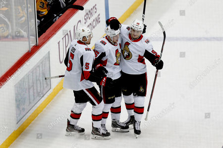 Ottawa Senators' Matt Duchene center celebrates with teammates Cody Ceci (5) and Maxime Lajoie (58) after scoring against the Pittsburgh Penguins during the third period of an NHL hockey game, in Pittsburgh. The Penguins won 5-3