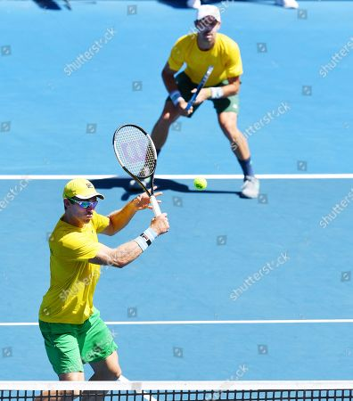 John Peers (front) and Jordan Thompson (back) of Australia in action during their doubles match on day two of the the Davis Cup qualifier between Australia and Bosnia and Herzegovina at Memorial Drive Tennis Club in Adelaide, South Australia, Australia, 02 February 2019.