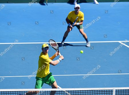 Stock Image of John Peers (front) and Jordan Thompson (back) of Australia in action during their doubles match on day two of the the Davis Cup qualifier between Australia and Bosnia and Herzegovina at Memorial Drive Tennis Club in Adelaide, South Australia, Australia, 02 February 2019.