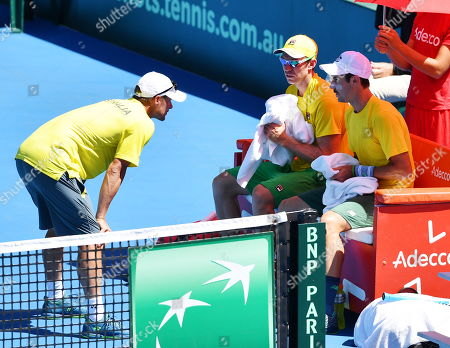 John Peers (2-R) and Jordan Thompson (R) of Australia are seen with Captain Lleyton Hewitt (L) during their doubles match on day two of the the Davis Cup qualifier between Australia and Bosnia and Herzegovina at Memorial Drive Tennis Club in Adelaide, South Australia, Australia, 02 February 2019.