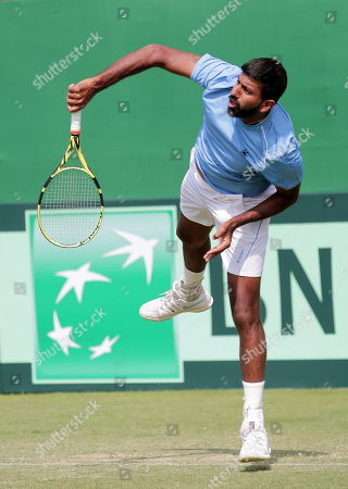 India's Rohan Bopanna in action during his doubles match with Divij Sharan against Matteo Berrettini and Simone Bolelli of Italy at the Davis Cup qualifiers round tie between India and Italy in Kolkata, eastern India, 02 February 2019.