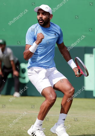 India's Divij Sharan reacts during his doubles match with Rohan Bopanna against Matteo Berrettini and Simone Bolelli of Italy at the Davis Cup qualifiers round tie between India and Italy in Kolkata, eastern India, 02 February 2019.