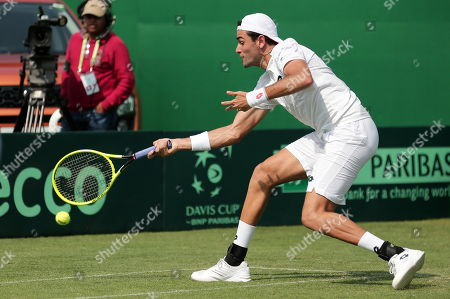 Italy's Matteo Berrettini in action during his doubles match with Simone Bolelli against Rohan Bopanna and Divij Sharan of India at the Davis Cup qualifiers round tie between India and Italy in Kolkata, eastern India, 02 February 2019.