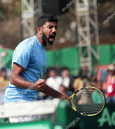 India's Rohan Bopanna celebrates after winning the doubles match with Divij Sharan against Matteo Berrettini and Simone Bolelli of Italy at the Davis Cup qualifiers round tie between India and Italy in Kolkata, eastern India, 02 February 2019.
