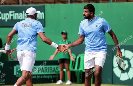 India's Divij Sharan (L) and Rohan Bopanna (R) celebrate after winning their doubles match against Matteo Berrettini and Simone Bolelli of Italy at the Davis Cup qualifiers round tie between India and Italy in Kolkata, eastern India, 02 February 2019.