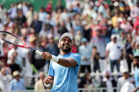 India's Divij Sharan celebrates after winning his doubles match with Rohan Bopanna against Matteo Berrettini and Simone Bolelli of Italy at the Davis Cup qualifiers round tie between India and Italy in Kolkata, eastern India, 02 February 2019.