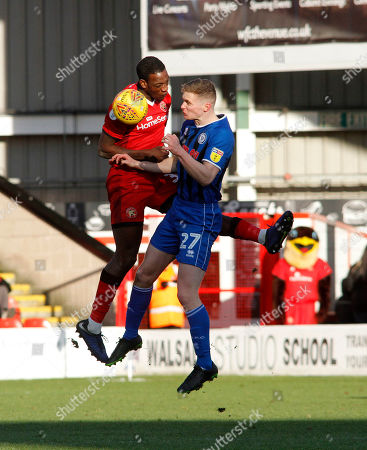 Isaiah Osbourne  of  Walsall with Ethan Hamilton of  Rochdale during the Sky Bet League 1 match at the Banks's Stadium, Walsall 02022019