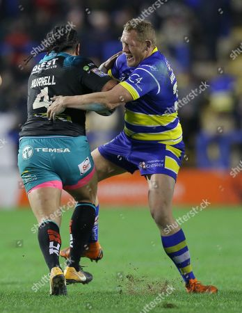 Ben Westwood of Warrington Wolves gets to grips with Konrad Hurrell of Leeds Rhinos
