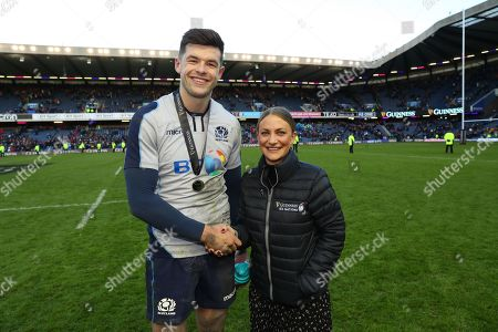 Scotland vs Italy. Scotland's Blair Kinghorn is awarded with the man of the match award by Kate Moore of Guinness