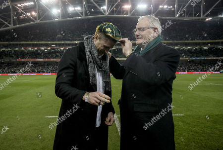 Ireland vs England. IRFU president Ian McIlrath presents former Ireland International Jamie Heaslip with an Irish Rugby cap for 100 tests