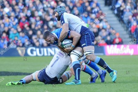 Abraham Steyn of Italy is tackled by James Ritchie and Josh Strauss during the 6 Nations match between Scotland and Italy at  BT Murrayfield, Edinburgh