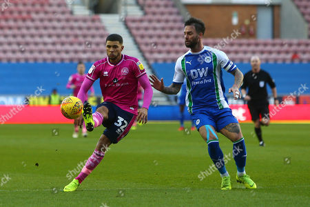 QPR's Nahki Wells and Wigan's Danny Fox