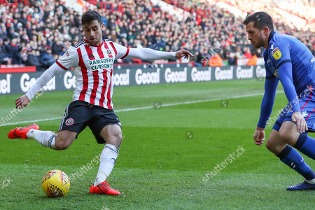 Sheffield United defender George Baldock (2) shapes to cross the ball under pressure from Bolton Wanderers defender Andrew Taylor (3) during the EFL Sky Bet Championship match between Sheffield United and Bolton Wanderers at Bramall Lane, Sheffield