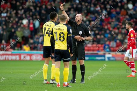 Yellow card for Scunthorpe United defender James Perch (14) during the EFL Sky Bet League 1 match between Barnsley and Scunthorpe United at Oakwell, Barnsley