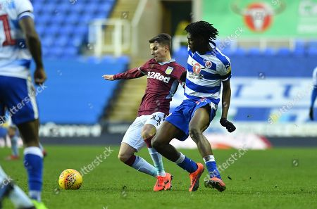 Aston Villa's Tom Carroll (11) and Reading's Ovie Ejaria during the EFL Sky Bet Championship match between Reading and Aston Villa at the Madejski Stadium, Reading
