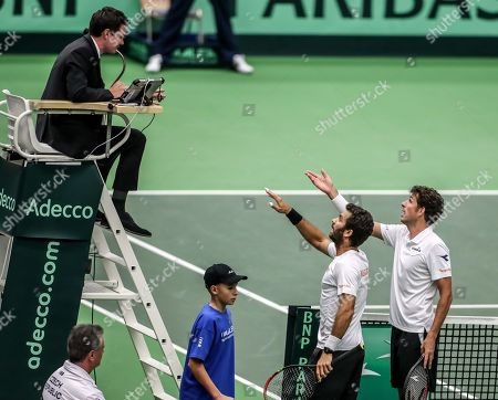 Robin Haase (R) and Jean-Julien Rojer (C) of the Netherlands discuss with referee in match against Lukas Rosol and Jiri Vesely of Czech Republic during the Davis Cup qualifier between Czech Repubic and the Netherlands in Ostrava, Czech Republic, 02 February 2019.