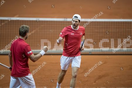 Oliver Marach (L) and Juergen Melzer (R) of Austria celebrate in their match against Marcelo Tomas Barrios Vera and Hans Podlipnik-Castillo of Chile during the Davis Cup qualifier between Austria and Chile in Salzburg, Austria 02, February 2019.
