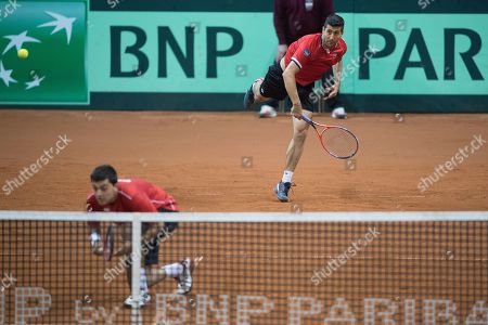 Marcelo Tomas Barrios Vera (L) and Hans Podlipnik-Castillo (R) of Chile in action against Juergen Melzer and Oliver Marach of Austria during the Davis Cup qualifier between Austria and Chile in Salzburg, Austria 02, February 2019.