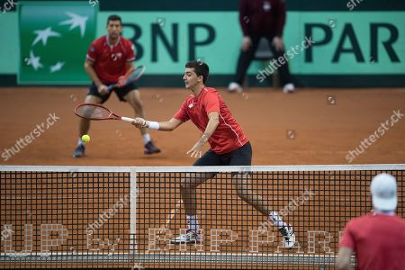 Hans Podlipnik-Castillo of Chile (L) and Marcelo Tomas Barrios Vera (R) of Chile in action against Juergen Melzer and Oliver Marach of Austria during the Davis Cup qualifier between Austria and Chile in Salzburg, Austria 02, February 2019.