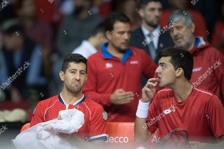 Hans Podlipnik-Castillo (L) and Marcelo Tomas Barrios Vera (R) of Chile dejected on the bench in their match against Juergen Melzer and Oliver Marach of Austria during the Davis Cup qualifier between Austria and Chile in Salzburg, Austria 02, February 2019.