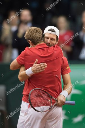 Oliver March (L) and Juergen Melzer (R) of Austria celebrate after winning in their match against Marcelo Tomas Barrios Vera and Hans Podlipnik-Castillo of Chile during the Davis Cup qualifier between Austria and Chile in Salzburg, Austria 02, February 2019.