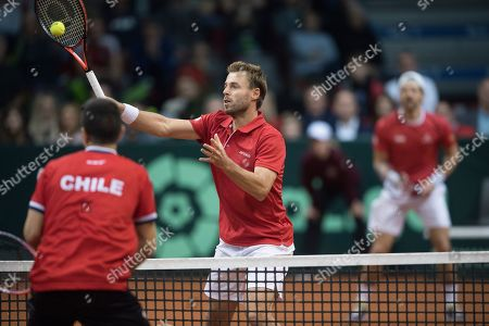 Oliver Marach (L) and Juergen Melzer (R) of Austria in action in their match against Marcelo Tomas Barrios Vera and Hans Podlipnik-Castillo of Chile during the Davis Cup qualifier between Austria and Chile in Salzburg, Austria 02, February 2019.