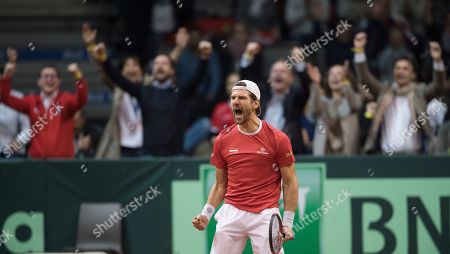 Stock Picture of Juergen Melzer  celebrates after winning with his teammate Oliver March both of Austria in their match against Marcelo Tomas Barrios Vera and Hans Podlipnik-Castillo of Chile during the Davis Cup qualifier between Austria and Chile in Salzburg, Austria 02, February 2019.