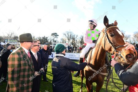 Leopardstown. Ladbrokes Dublin Chase. Winners MIN and Ruby Walsh are greeted by owner Rich Ricci after their win.