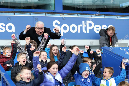 Everton chairman Bill Kenwright cheers as he poses for pictures with match day mascots