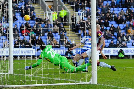 Matt Miazga (19) of Reading shoots wide as Lovre Kalinic (28) of Aston Villa dives to cover his post during the EFL Sky Bet Championship match between Reading and Aston Villa at the Madejski Stadium, Reading