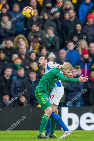 Glenn Murphy (Brighton) and Will Hughes (Watford) during the Premier League match between Brighton and Hove Albion and Watford at the American Express Community Stadium, Brighton and Hove