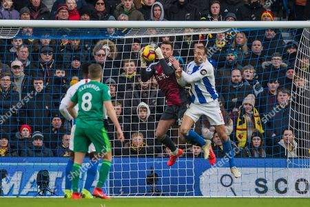Ben Foster (GK) (Watford) saves the ball with Glenn Murphy (Brighton) very close by during the Premier League match between Brighton and Hove Albion and Watford at the American Express Community Stadium, Brighton and Hove