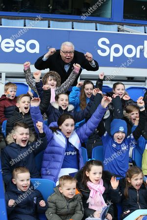 Everton Chairman Bill Kenwright with young fans before the Premier League match between Everton and Wolverhampton Wanderers at Goodison Park, Liverpool