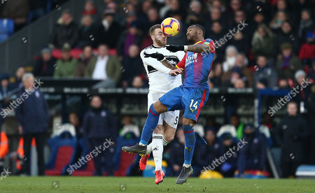 Calum Chambers of Fulham battles with  Jordan Ayew of Crystal Palace