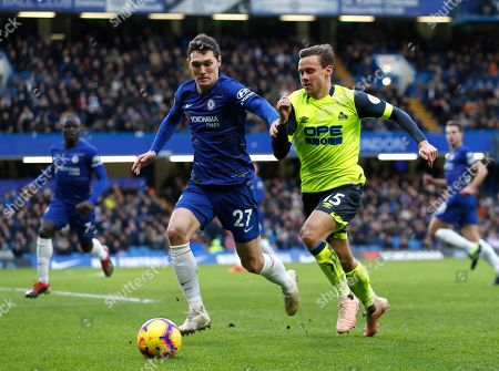 Chelsea's Andreas Christensen, left, and Huddersfield Town's Chris Lowe challenge for the ball during the English Premier League soccer match between Chelsea and Huddersfield Town at Stamford Bridge stadium in London, Britain