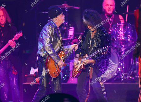 Joe Perry, Brad Whitford. Joe Perry and Brad Whitford with Aerosmith performs during the Bud Light Super Bowl Music Fest Day 2 at State Farm Arena, in Atlanta