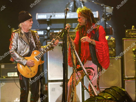 Steven Tyler, Brad Whitford. Steven Tyler and Brad Whitford with Aerosmith performs during the Bud Light Super Bowl Music Fest Day 2 at State Farm Arena, in Atlanta