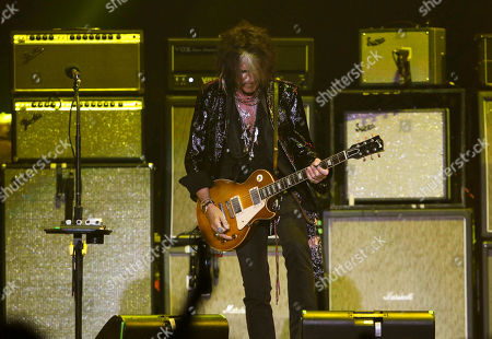 Joe Perry with Aerosmith performs during the Bud Light Super Bowl Music Fest Day 2 at State Farm Arena, in Atlanta