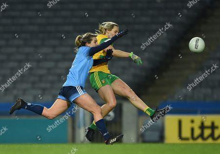 Dublin vs Donegal. Donegal's Karen Guthrie scores a point despite the effort of Martha Byrne of Dublin