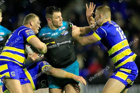 Warringtons  mike Cooper Ben Westwood and Jack Hughes tackled by Leeds Brett Ferres